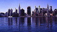 [Reflections of Empire and Chrysler Buildings on East River]