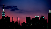 [Sunset Behind Empire State and Chrysler Buildings]